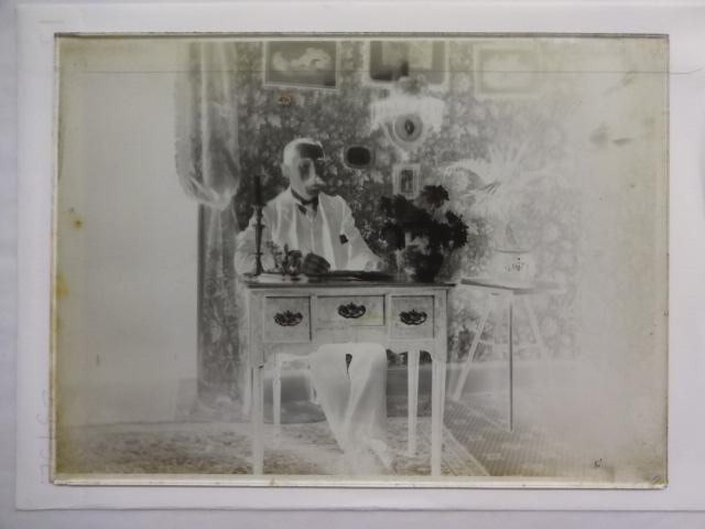 Dr Baker at a desk