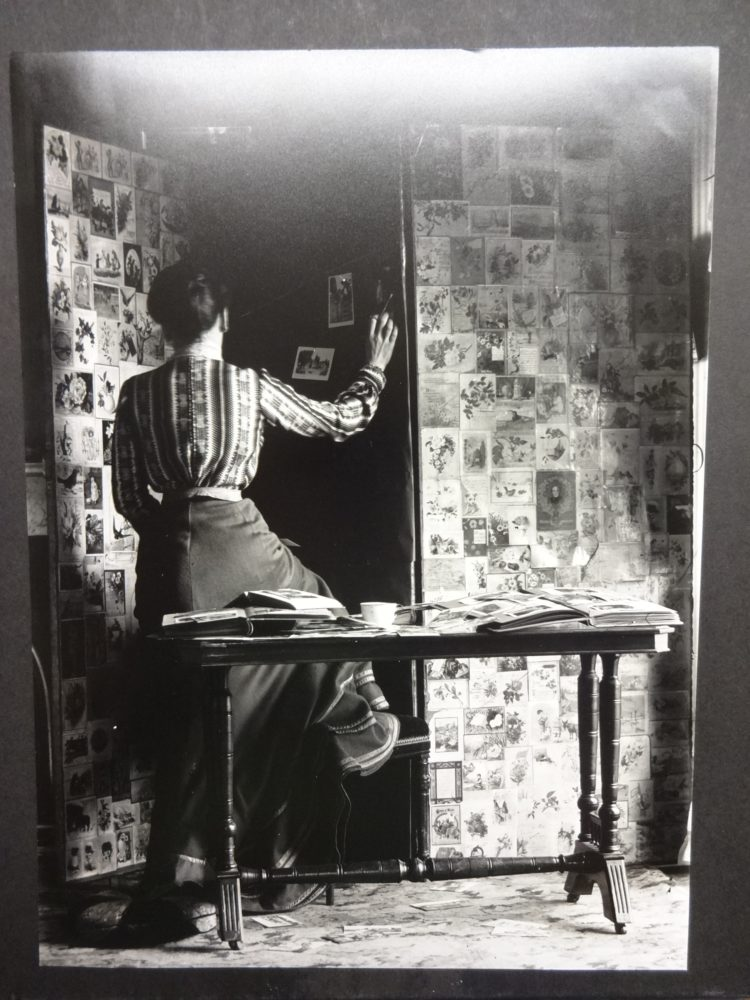Unidentified lady assembling photographs on a screen